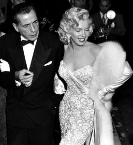 Marilyn Monroe and Humphrey Bogart at the premiere for How To Marry A Millionaire in November 1953.