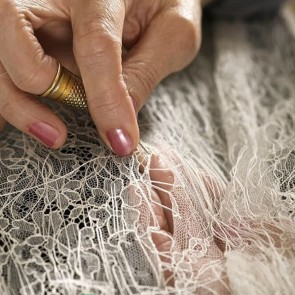 "The lace shivers if it is ""undressed"" in certain places. But magic fingers move lightly over the surface to cleverly rectify errors and skillfully make all the threads beautiful. #sophiehallette #lace #dentelledecalaiscaudry #madeinfrance #manufacturing #workshops #leaverslace © Philippe Schlienger"